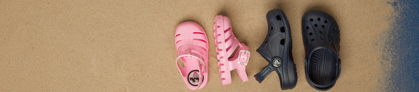 shop kids sandals inclucing crocs and juju at schuh