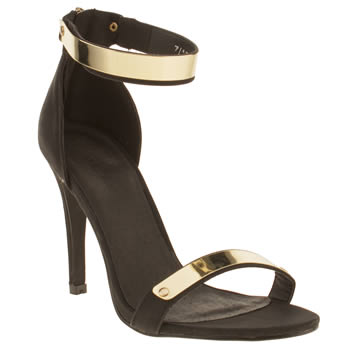 Schuh Black & Gold Grind My Gears High Heels