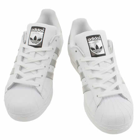 white adidas superstar trainers