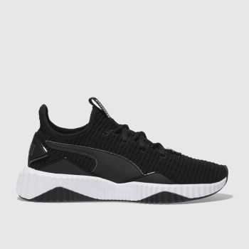 0eb7649f3eb958 womens black   white puma defy trainers