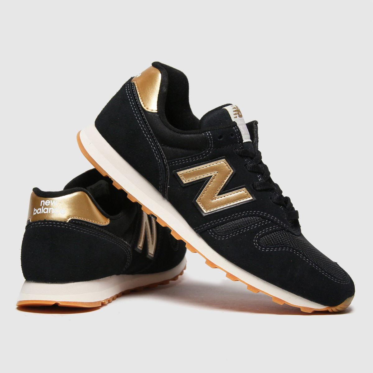 New balance black & gold 373 trainers